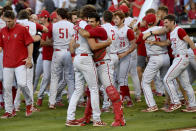 North Carolina State players Evan Justice (34) and Luca Tresh (24) hug following their 3-2 win over Arkansas during an NCAA college baseball super regional game Sunday, June 13, 2021, in Fayetteville, Ark. (AP Photo/Michael Woods)