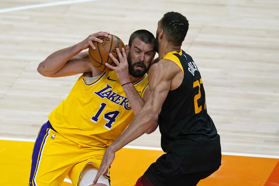Utah Jazz center Rudy Gobert (27) defends against Los Angeles Lakers center Marc Gasol (14) during the first half of an NBA basketball game Wednesday, Feb. 24, 2021, in Salt Lake City. (AP Photo/Rick Bowmer)