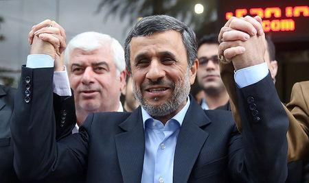 Ex-Iranian President Mahmoud Ahmadinejad reacts as he submits his name for registration as a candidate in Iran's presidential election, in Tehran