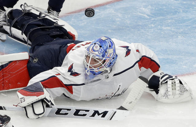 Washington Capitals' Pheonix Copley hits the ice while deflecting the puck in the second period of an NHL preseason hockey game against the Boston Bruins, Sunday, Sept. 16, 2018, in Boston. (AP Photo/Steven Senne)