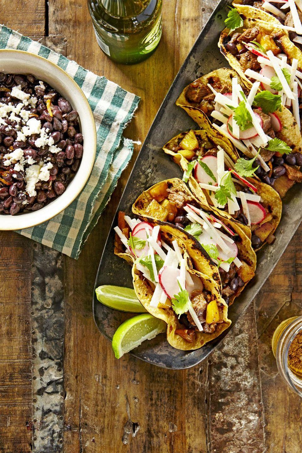 """<p>Bring on the <a href=""""https://www.goodhousekeeping.com/food-recipes/cooking/tips/g1935/cut-whole-pineapple/"""" rel=""""nofollow noopener"""" target=""""_blank"""" data-ylk=""""slk:pineapple"""" class=""""link rapid-noclick-resp"""">pineapple</a>! (Plus, and save some extra slices for snacking.)</p><p><em><a href=""""https://www.countryliving.com/food-drinks/recipes/a39826/beef-and-pineapple-tacos-with-mojo-beans-recipe/"""" rel=""""nofollow noopener"""" target=""""_blank"""" data-ylk=""""slk:Get the recipe from Country Living »"""" class=""""link rapid-noclick-resp"""">Get the recipe from Country Living »</a></em></p>"""