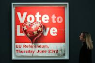 A staff member views Banksy's painting titled Vote to Love (Est �400,000 - �700,000) at the preview of Sotheby's Contemporary Art. The auction will take place at Sotheby's in central London on 11 and 12 February 2020. (Photo by Dinendra Haria / SOPA Images/Sipa USA)