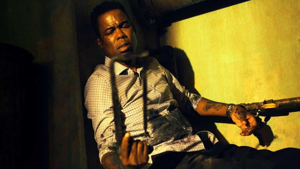 <p>Do you want to play a game? Chris Rock is in a <em>Saw</em> sequel. Well, it's kind of a sequel and kind of its own thing. When a twisted killer matching the traits of <em>Saw's</em> Jigsaw killer begins tallying up the body count, a determined police vet (Samuel L. Jackson) and a cocky detective (Rock) unravel the dangerous mystery. Expect body parts to fly on May 21, 2021.</p>