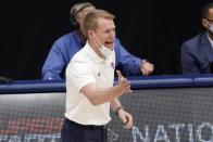 Louisiana Tech head coach Eric Konkol instructs his team in the first half of an NCAA college basketball game against Mississippi State in the semifinals of the NIT, Saturday, March 27, 2021, in Frisco, Texas. (AP Photo/Tony Gutierrez)