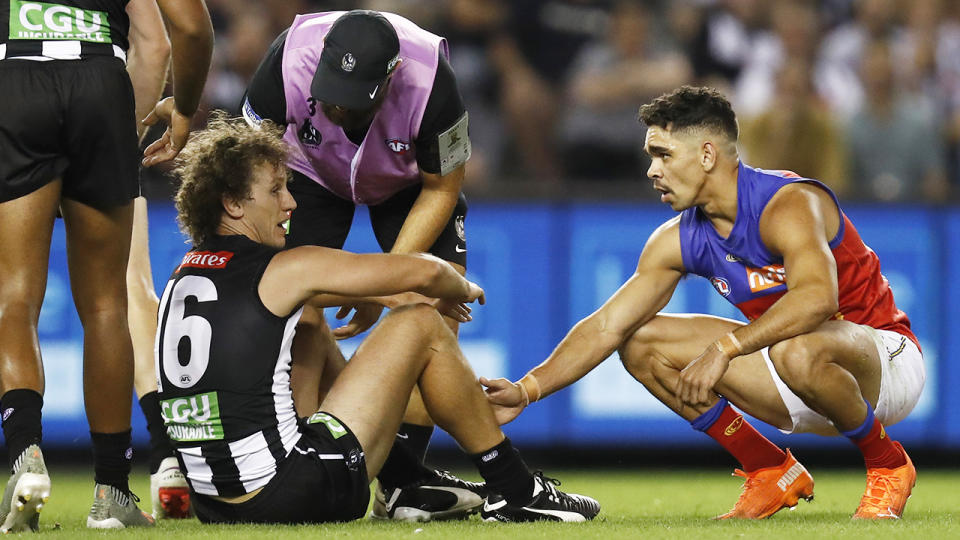 Collingwood's Chris Mayne argued with club doctors and initially refused to undergo a concussion test after a clash with Brisbane rival Charlie Cameron. (Photo by Darrian Traynor/Getty Images)