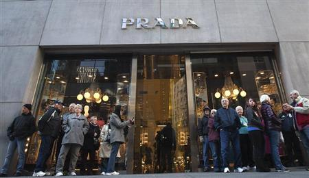 People stand outside a Prada store on 5th Ave during Black Friday Sales in New York