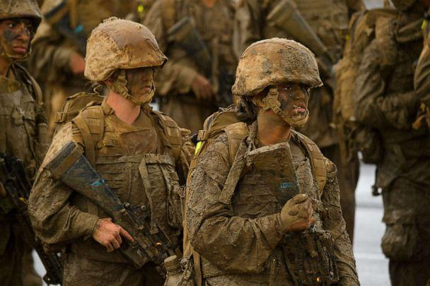 PHOTO: United States Marine Corps (USMC) recruits from Lima Company, the first gender integrated training class in San Diego, march, April 21, 2021, at Camp Pendleton. (Patrick T. Fallon/AFP via Getty Images)