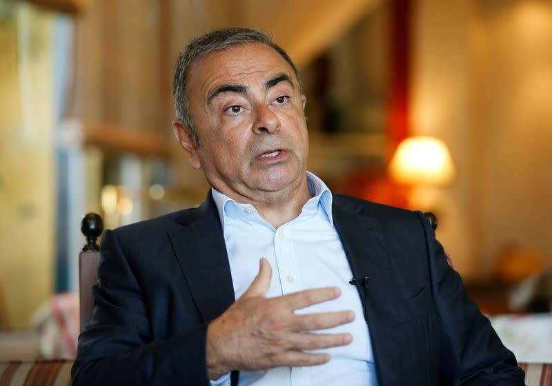 Fugitive former car executive Carlos Ghosn, gestures as he talks during an interview with Reuters in Beirut