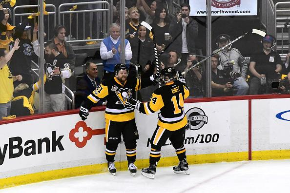 PITTSBURGH, PA - MAY 15: Phil Kessel #81 of the Pittsburgh Penguins celebrates with Chris Kunitz #14 after scoring a goal against Craig Anderson #41 of the Ottawa Senators during the third period in Game Two of the Eastern Conference Final during the 2017 NHL Stanley Cup Playoffs at PPG PAINTS Arena on May 15, 2017 in Pittsburgh, Pennsylvania. (Photo by Matt Kincaid/Getty Images)