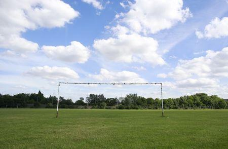 Soccer goalposts stand in a playing field in Hackney Marshes in east London May 25, 2014. The 2014 Brazil World Cup opens on June 12 and fans around the globe are gearing up for the big tournament. But soccer lovers are not only preparing to watch the world's best professional players battle it out on the pitch; they are also out there kicking a ball about themselves. Reuters photographers on every continent, in countries from China to the Czech Republic, went out to capture images of soccer goalposts used by players to practise the 'beautiful game'. Picture taken May 25, 2014.  REUTERS/Russell Boyce (BRITAIN - Tags: SPORT SOCCER WORLD CUP SOCIETY)  ATTENTION EDITORS: PICTURE 43 OF 60 FOR PACKAGE '2014 WORLD CUP - AROUND THE WORLD IN 60 GOALS' TO FIND ALL IMAGES SEARCH 'GLOBAL GOALPOSTS' - RTR3SUWR