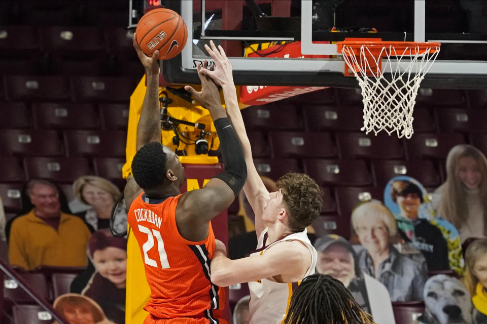 Illinois' Kofi Cockburn (21) shoots over Minnesota's Liam Robbins (0) in the first half of an NCAA college basketball game, Saturday, Feb. 20, 2021, in Minneapolis. (AP Photo/Jim Mone)