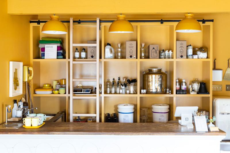 The bulk refill station has selections of detergent, soap, and cleaning products by 2 Note Hudson, The Unscented Company, and Meliora Cleaning Products.