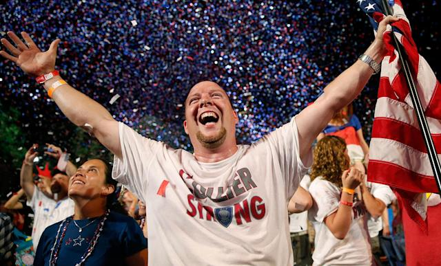 <p>Scott Webb, of Waldorf, Md., celebrates during the finale of the Boston Pops Fourth of July Concert at the Hatch Shell in Boston, Mass., Thursday, July 4, 2013. (Photo: Michael Dwyer/AP) </p>