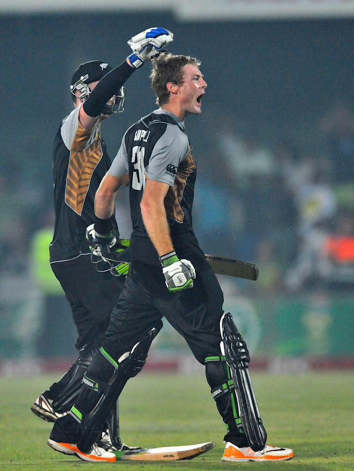 EAST LONDON, SOUTH AFRICA - DECEMBER 23: Martin Guptil of New Zealand celebrates his 100 with Colin Munro off the last ball to win the match during the 2nd T20 match between South Africa and New Zealand at Buffalo Park on December 23, 2012 in East London, South Africa.  (Photo by Duif du Toit/Gallo Images/Getty Images)