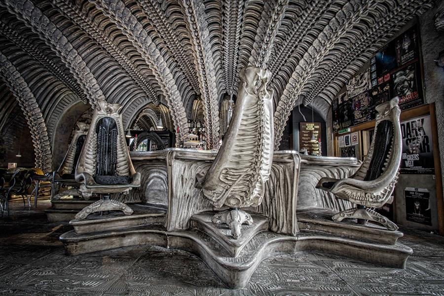 <p>Wonder what Jonah would have felt like when he was swallowed by the whale? All you need to do is step inside the H.R. Giger Museum Bar. This bar in Gruyères, Switzerland, has been modelled by artist HR Giger around the work he did for the popular 'Alien' movie. Arches of vertebrae of a prehistoric beast crisscross high up above to create a cavernous space inside a seemingly ancient castle. The effect is very otherworldly and makes for a fascinating location for a drink. </p>
