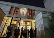 Worshippers leave after Mass at St. Joseph's Chaldean Cathedral in the Iraqi capital Baghdad