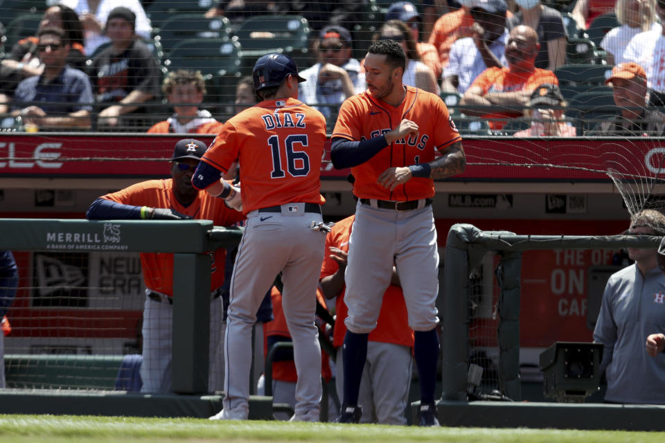 Houston Astros' Aledmys Diaz, left, is congratulated by teammate Carlos Correa after hitting a two-run home run against the San Francisco Giants during the third inning of a baseball game in San Francisco, Saturday, July 31, 2021. (AP Photo/Jed Jacobsohn)