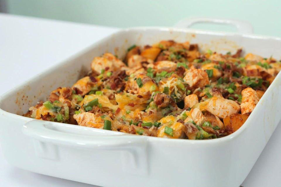 """<p><b>Recipe: <a href=""""https://www.southernliving.com/syndication/loaded-potato-buffalo-chicken-casserole"""" rel=""""nofollow noopener"""" target=""""_blank"""" data-ylk=""""slk:Loaded Potato and Buffalo Chicken Casserole"""" class=""""link rapid-noclick-resp"""">Loaded Potato and Buffalo Chicken Casserole</a></b></p> <p>It's like taking two fall football favorites—loaded potatoes and buffalo chicken—and combining them into a warm, gooey casserole. You're welcome. </p>"""