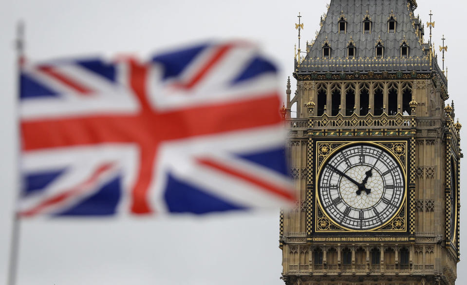 """FILE - In this Wednesday, March 29, 2017 file photo British Union flag waves in front of the Elizabeth Tower at Houses of Parliament containing the bell know as """"Big Ben"""" in central London. Britain and the European Union have struck a provisional free-trade agreement that should avert New Year's chaos for cross-border commerce and bring a measure of certainty to businesses after years of Brexit turmoil. The breakthrough on Thursday, Dec. 24, 2020 came after months of tense and often testy negotiations that whittled differences down to three key issues: fair-competition rules, mechanisms for resolving future disputes and fishing rights. (AP Photo/Matt Dunham, File)"""
