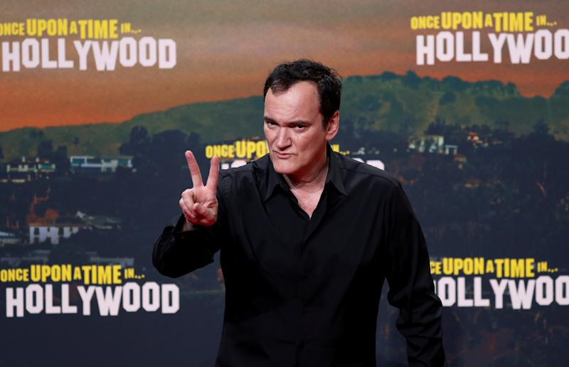 "Director Quentin Tarantino gestures as he arrives for the Berlin premiere of ""Once Upon a Time in Hollywood"",in Berlin, Germany, August 1, 2019. REUTERS/Fabrizio Bensch"