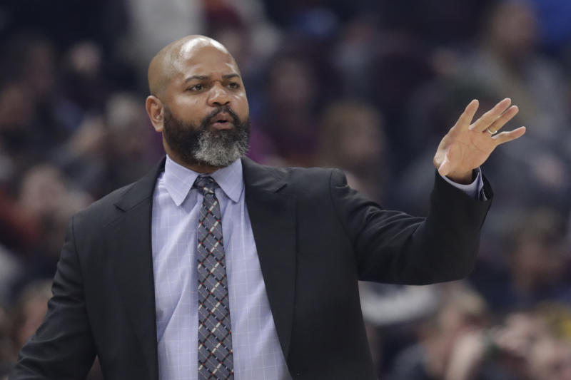 FILE - In this March 2, 2020 file photo, Cleveland Cavaliers head coach J.B. Bickerstaff gives instructions to players in the first half of an NBA basketball game against the Utah Jazz in Cleveland.  On Friday, March 6 Bickerstaff, Andre Drummond, Cavs guards Collin Sexton and Darius Garland, forwards Cedi Osman, Dante Exum and Dylan Windler, spent several hours visiting with offenders at Grafton _ a medium security prison housing 1,700 residents _ to share fellowship as well as some hope and hoops.(AP Photo/Tony Dejak, File)