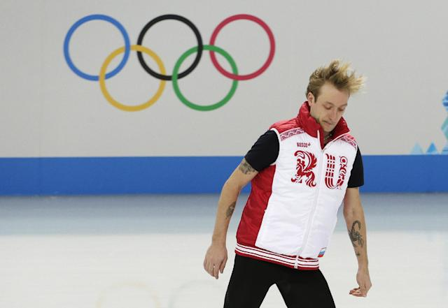 Evgeny Plyushchenko of Russia warms up before a men's figure skating training session at the Iceberg Skating Palace ahead of the 2014 Winter Olympics, Wednesday, Feb. 5, 2014, in Sochi, Russia. (AP Photo/Bernat Armangue)