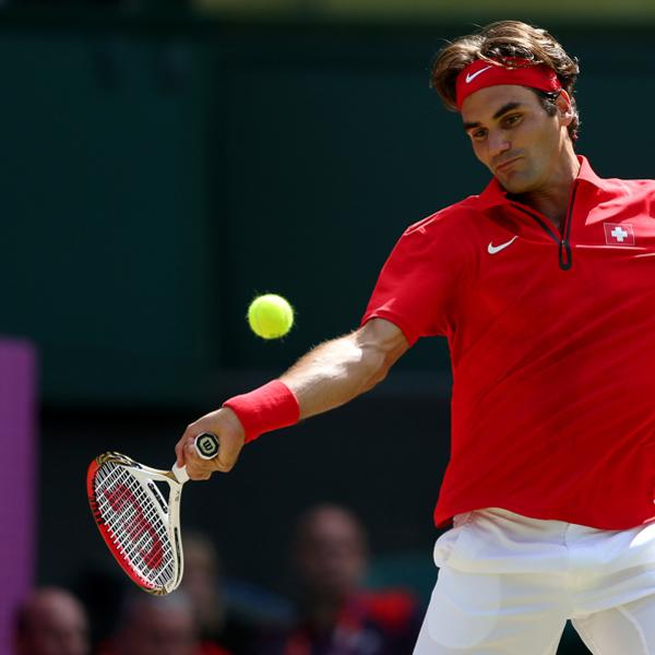 LONDON, ENGLAND - AUGUST 05:  Roger Federer of Switzerland returns a shot against Andy Murray of Great Britain during the Men's Singles Tennis Gold Medal Match on Day 9 of the London 2012 Olympic Games at the All England Lawn Tennis and Croquet Club on August 5, 2012 in London, England.  (Photo by Clive Brunskill/Getty Images)