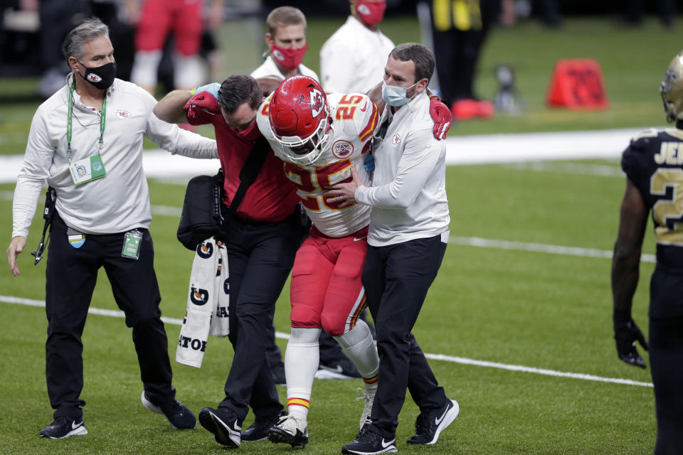 Kansas City Chiefs running back Clyde Edwards-Helaire (25) is helped off the field after being injured in the second half of an NFL football game against the New Orleans Saints in New Orleans, Sunday, Dec. 20, 2020. (AP Photo/Brett Duke)