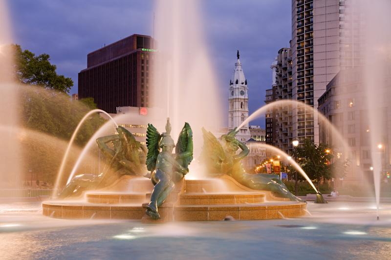 Philadelphia's Swann Memorial Fountain by Alexander Calder's father, with a sculpture of William Penn atop City Hall by his grandfather, in the background.