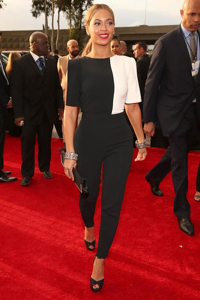 Beyonce arrives at the red carpet differently in a black and white Osman pantsuit.