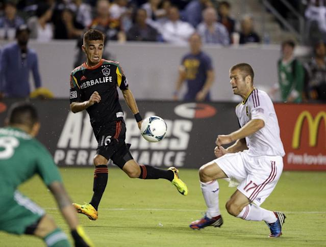 Real Salt Lake defender Chris Wingert, right, and Los Angeles galaxy midfielder Hector Jimenez vie in front of the goal in the first half of an MLS soccer game in Carson, Calif., Saturday, Aug. 17, 2013. (AP Photo/Reed Saxon)