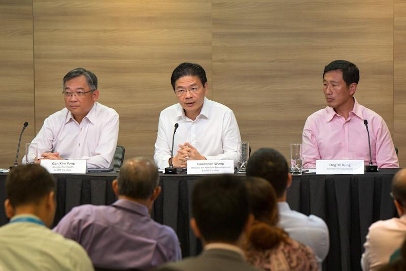 (L-R) Singapore's Health Minister Gan Kim Yong, National Development Minister Lawrence Wong and Education Minister Ong Ye Kung at a press conference on the latest developments with regard to the spread of the Wuhan, at the Ministry of Communications and Information on Monday, 27 January 2020. PHOTO: Dhany Osman/Yahoo News Singapore