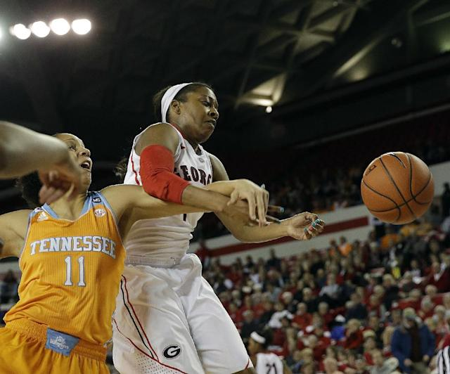 Georgia guard Sydnei McCaskill, right, and Tennessee forward Cierra Burdick (11) battle for a rebound in the first half of an NCAA college basketball game Sunday, Jan. 5, 2014, in Athens, Ga. (AP Photo/John Bazemore)