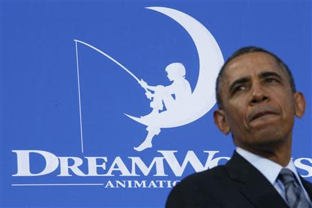 U.S. President Barack Obama looks on while delivering remarks to workers on the economy at DreamWorks Animation in Glendale, California, November 26, 2013. REUTERS/Jason Reed