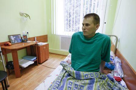 A man, who according to Ukraine's state security service (SBU) is named Alexander Alexandrov and is one of two Russian servicemen recently detained by Ukrainian forces, speaks during an interview with Reuters at a hospital in Kiev, Ukraine, May 28, 2015. REUTERS/Valentyn Ogirenko