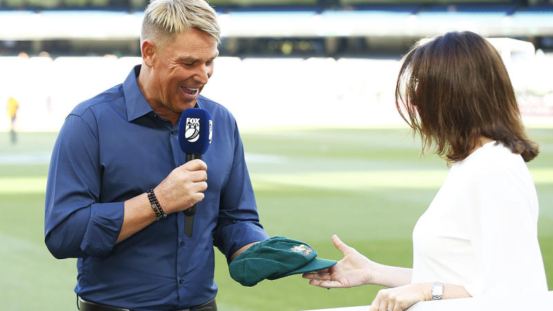 Shane Warne handed over his baggy green, after the Commonwealth Bank paid $1 million for it in a bushfire relief auction. (Photo by Daniel Pockett - CA/Cricket Australia via Getty Images )