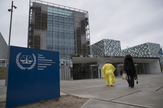 Supporters of former Ivory Coast President Laurent Gbagbo walk towards the International Criminal Court in The Hague, Netherlands, Wednesday, Jan. 16, 2019, where lawyers were scheduled to discuss the next steps in the case of Gbagbo and ex-youth minister Charles Ble Goude, a day after both men were acquitted of crimes against humanity. (AP Photo/Peter Dejong)