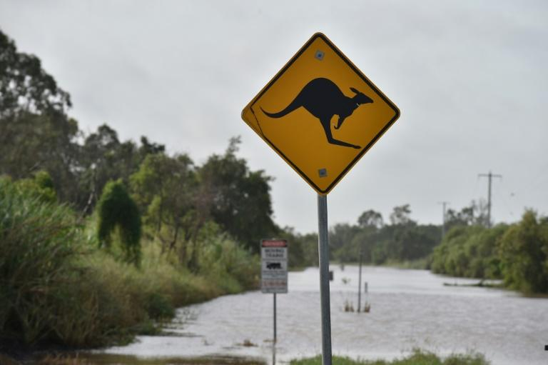 Torrential rain is hampering relief efforts after a powerful cyclone wreaked havoc in northeast Australia, with floods sparking emergency rescues as fed-up tourists wait to be evacuated from resort islands