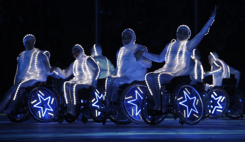 Actors perform at the Fisht Olympic stadium during the closing ceremony of the 2014 Winter Paralympics at the Fisht Olympic stadium in Sochi, Russia, Sunday, March 16, 2014. (AP Photo/Dmitry Lovetsky)