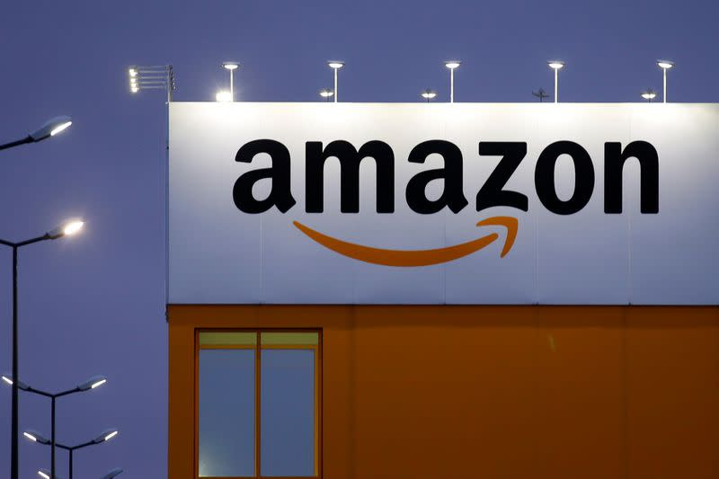 FILE PHOTO: The logo of Amazon is seen at the company logistics center in Lauwin-Planque, northern France