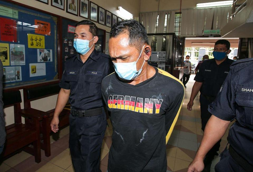 Scrap metal worker Arnee Ahamad Pazir claimed trial at the Magistrate's Court in Ipoh to causing riot and damage to the Lahat police station here and also injuring a policeman in the process on January 24, 2021. — Picture by Farhan Najib