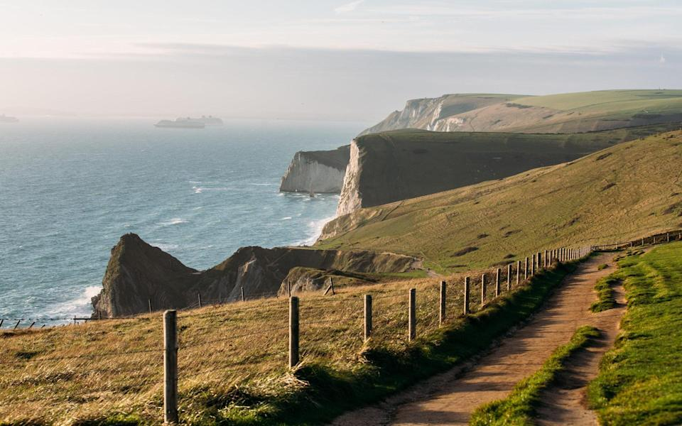 A trip to Durdle Door, in Dorset, features on a Saga itinerary - Getty