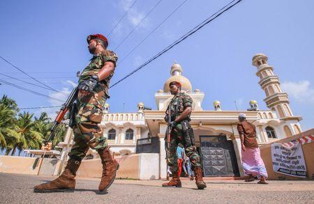 Sri Lankan military stand guard outside a mosque after clashes between two sectarian groups in a beachside resort in Poruthota village in Negombo, Sri Lanka May 6, 2019. REUTERS/Stringer