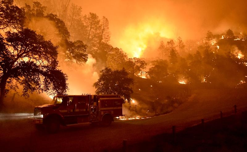 Wildfires have waged a relentless campaign in the drought-stricken western United States this year, mobilizing some 30,000 firefighters, National Guard units and rescuers from across the country (AFP Photo/Josh Edelson)