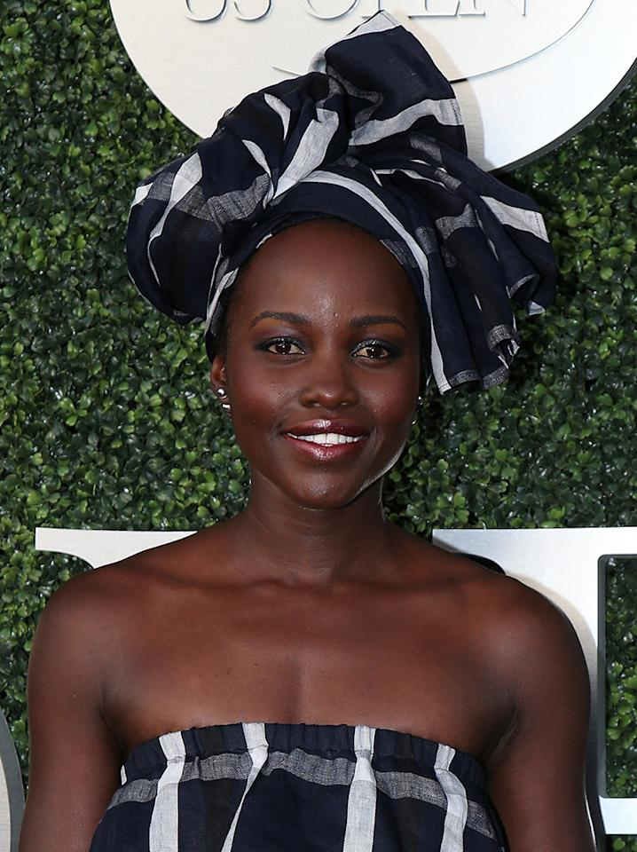 <p>The Oscar-winning actress attended day two of the U.S. Open wearing a black-and-white head wrap and matching crop top. Smoky eye makeup and burgundy lipstick completed the look. (Photo: Getty Images) </p>