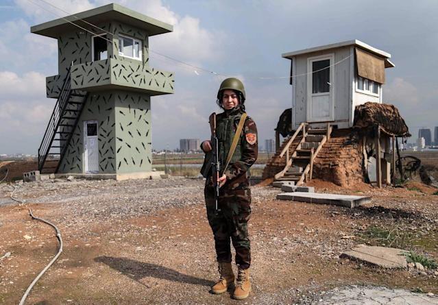 <p>Arazo Qadri, a 27-year-old female member of the Iraqi Kurdish Peshmerga, stands guard at the Peshmerga Military camp in Arbil, the capital of the Kurdish autonomous region in northern Iraq, on February 20, 2018. (Photo: Safin Hamed/AFP/Getty Images) </p>