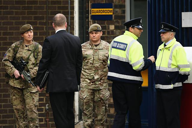 LONDON, ENGLAND - MAY 23: Security is tightened around Woolwich Barracks on May 23, 2013 in London, England. A British soldier was murdered by suspected Islamists near London's Woolwich Army Barracks yesterday in a savage knife attack. British Prime Minister David Cameron has said that the 'appalling' attack appeared to be terror related. (Photo by Dan Kitwood/Getty Images)