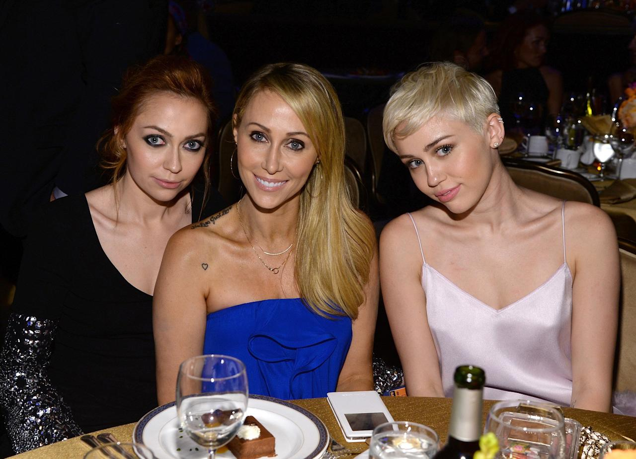 """<a href=""""https://people.com/music/miley-cyrus-had-a-terrifying-plane-ride-with-her-mom-and-sister-on-the-way-to-glastonbury-festival/"""">On a July 2019 episode of her podcast</a>, Brandi recalled a scary landing the family experienced en route to that year's Glastonbury music festival in England.  """"Out of nowhere, as we're landing, we swoop back up and like bank to the left, and turn and like, it feels crazy,"""" she said, adding that her mom and sister, who are nervous flyers, """"just start losing their minds.""""  """"So we're sitting here thinking like what in the world is going on,"""" she said.  After a few tense moments, Brandi said that the flight crew eventually explained that there was """"no need to panic, but somebody was in our lane in the sky, and we were going to hit them, so we had to come back up and move.""""  """"That's terrifying to think about,"""" Brandi said. """"Like, you're going like what? 400 miles an hour? And a plane is like, in your lane, like that's insane.""""  But her story didn't end there.  """"After like 10 minutes of circling us around, they go back to land again — same frickin' thing happens,"""" Brandi said, revealing that this time there was a plane in the way on the runway. """"They had to swoop back up and bank again.""""  Brandi said that her mom started crying after the second mishap, and tearfully expressed fear for the youngest Cyrus daughter, who wasn't with them on the trip: """"She's like, 'if we die, Noah's alone!' and like freaking out.""""  Apparently, the flight crew told them that it was hard to land because so many planes were arriving for the festival.  Though the encounter sounds harrowing, thankfully, the group eventually landed safely and made it to the festival."""
