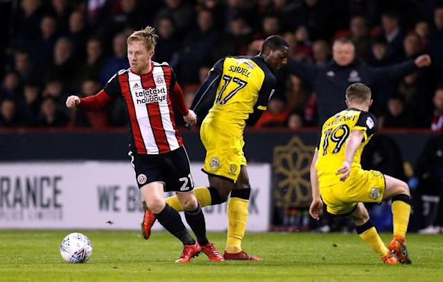 "Soccer Football - Championship - Sheffield United vs Burton Albion - Bramall Lane, Sheffield, Britain - March 13, 2018 Sheffield United's Mark Duffy in action with Burton's Marvin Sordell and Jacob Davenport Action Images/Ed Sykes EDITORIAL USE ONLY. No use with unauthorized audio, video, data, fixture lists, club/league logos or ""live"" services. Online in-match use limited to 75 images, no video emulation. No use in betting, games or single club/league/player publications. Please contact your account representative for further details."