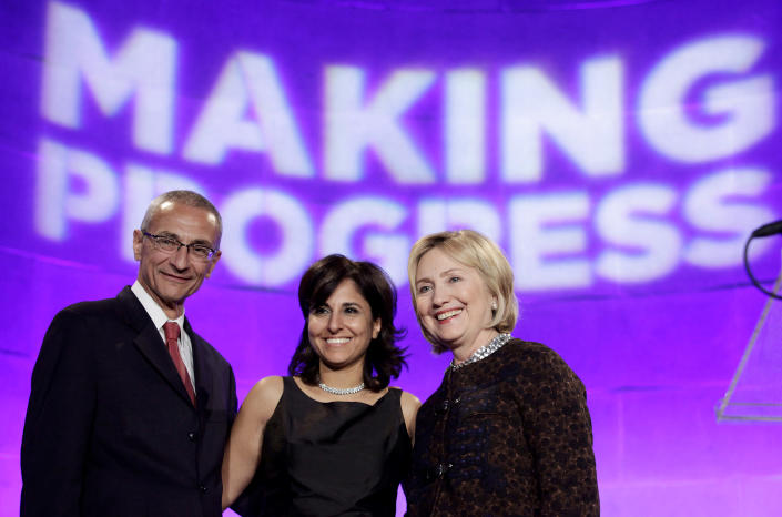 Former Secretary of State Clinton poses with President of CAP Neera Tanden and CAP Chairman John Podesta at the 10th Anniversary policy forum in Washington (Yuri Gripas / Reuters file)